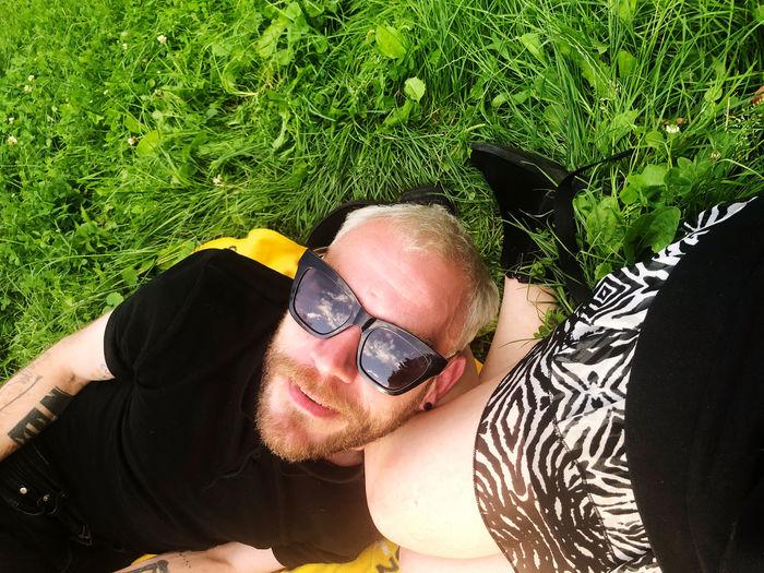 Portrait of man lying down on field