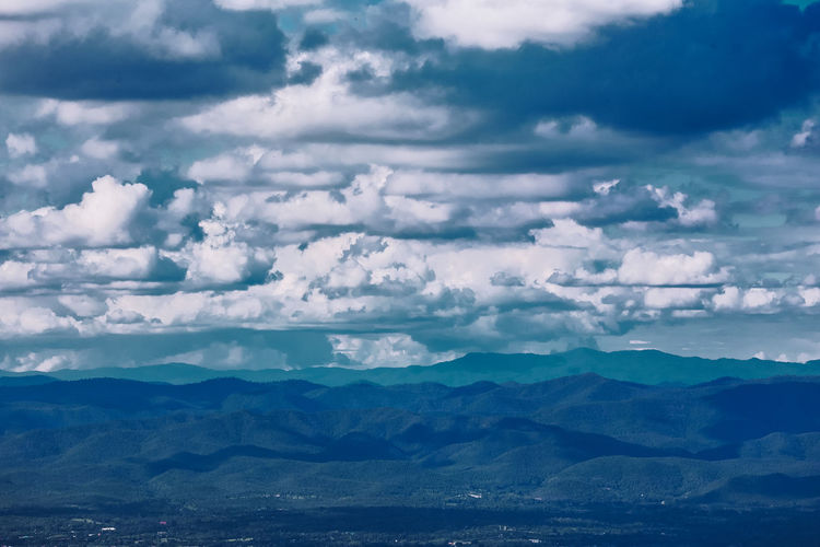 Aerial view of landscape against dramatic sky