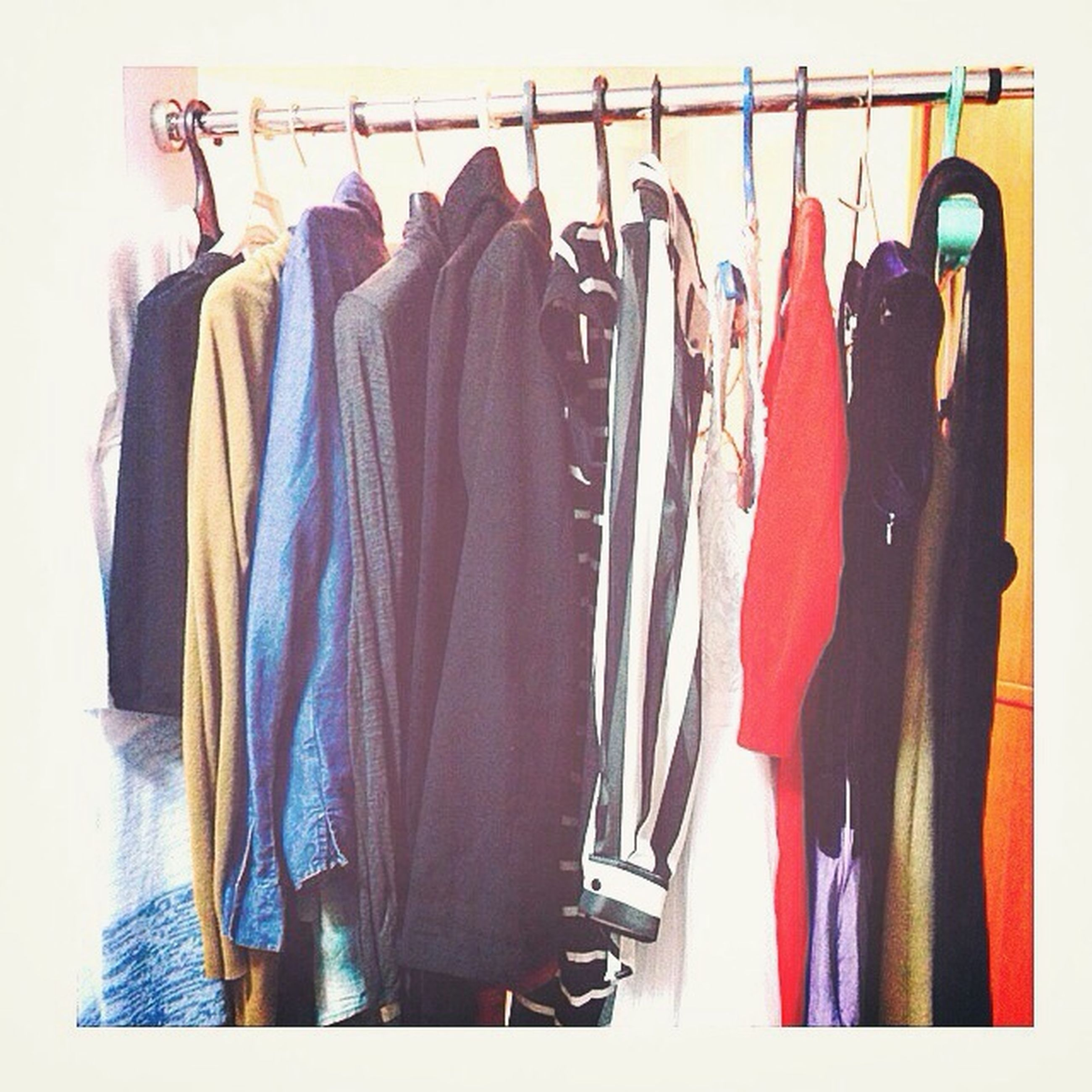 indoors, variation, clothing, hanging, still life, choice, large group of objects, in a row, coathanger, textile, arrangement, fashion, abundance, retail, side by side, equipment, musical instrument, close-up, shopping, group of objects