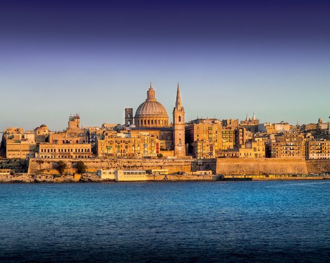 Malta Valetta - old town - Amazing front view during sunset. Architecture Built Structure Place Of Worship Outdoors Travel Destinations Water No People Blue Day Clear Sky City Nature Cityscape Building Exterior Daylight Imagination Religion Colourful Balconies Meyer-Optik-Görlitz Sharp Focus Capital Cities  Character Design  Neighborhood Map The Great Outdoors - 2017 EyeEm Awards Live For The Story