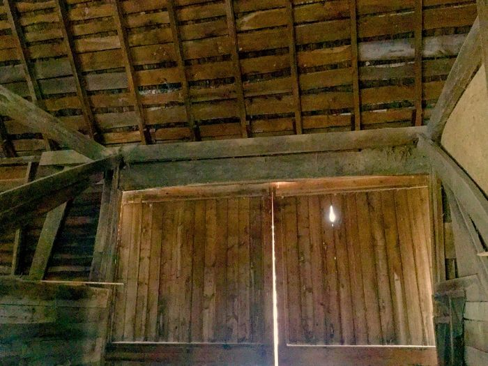 Rustic barn Abandoned Allegan Michigan Bad Condition Beautiful Old Barn Wood Brown Damaged Deterioration Door Full Frame Indoors  Inside Old Barn No People Obsolete Old Old Barn Plank Ruined Rural Life Symmetry Text Wall Western Script Wood Wood - Material Wooden