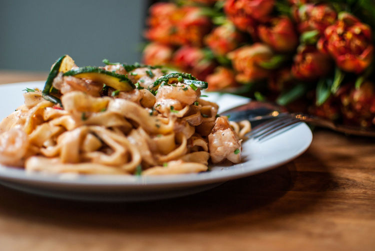Close-up of tagliatelle pasta served in plate on table