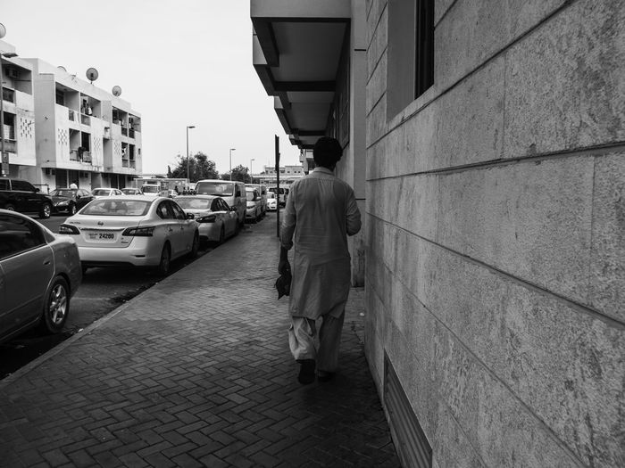 Alone Dubai Walking Around Architecture Building Exterior City Monochrome monochrome photography One Person People Real People Rear View Street Street Photography Streetphoto_bw Streetphotography Transportation Walking