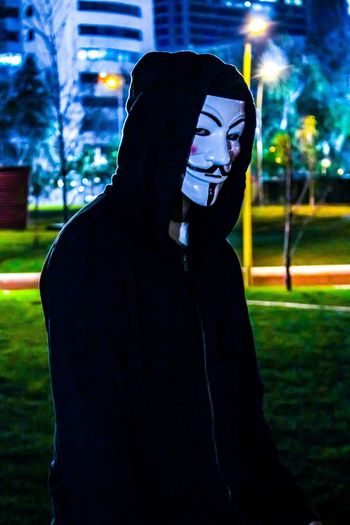 Anonymous Anonymous Mask Night Focus On Foreground One Person Lifestyles Illuminated People EyeEm Selects Chile Urbexphotography Urbexexplorer Urbex Multi Colored Urbexchile Men Light And Shadow Santiago Santiago De Chile