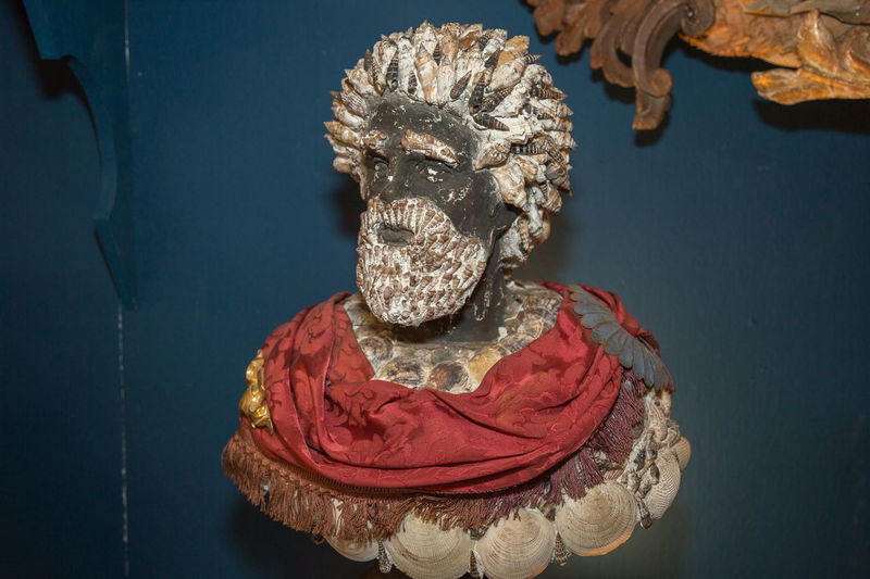 Bust, sculpture of a man with a beard made with sea shells.