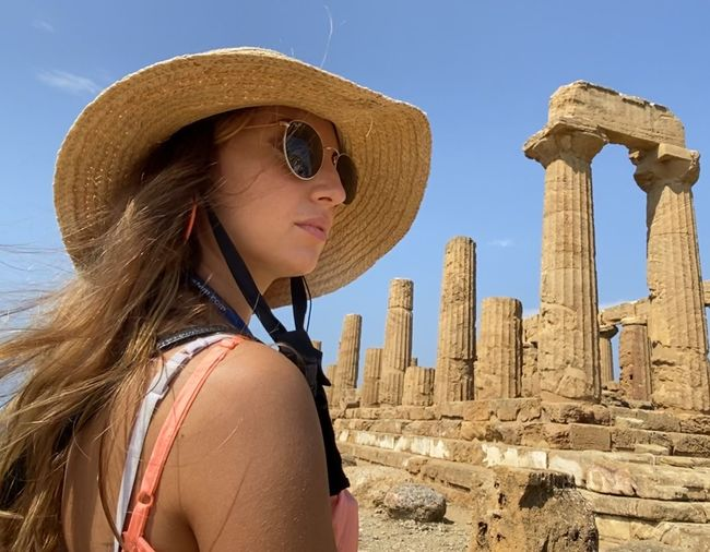Young woman wearing sunglasses against sky