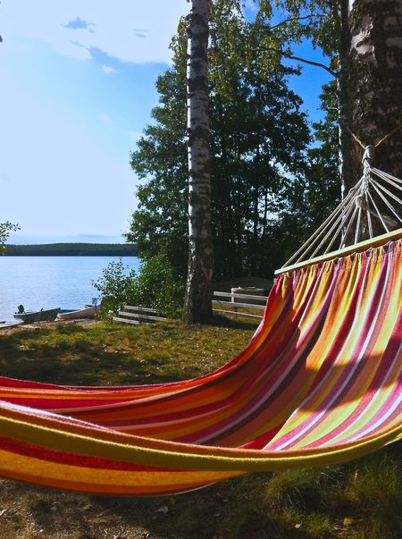 Beauty In Nature Finland Hammock Lake Multi Colored No People Outdoors Peaceful View Quiet Moments Relaxing Summer Tranquility Travel Destinations Waterfront Suomi100 Suomifinland100 Summer Views Summertime Presentation Background Midsummer In Finland Sea And Sky Lakeside Lake View