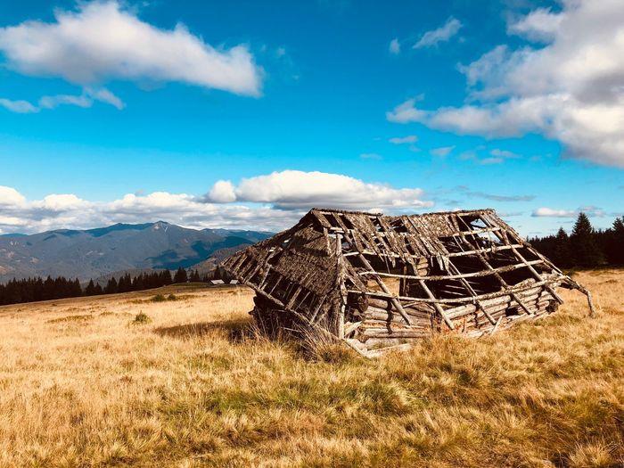 Abandoned Barn On Field Against Sky