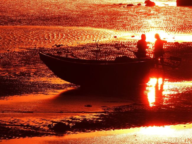 Sunset Water Orange Color Nature Real People Beauty In Nature Silhouette