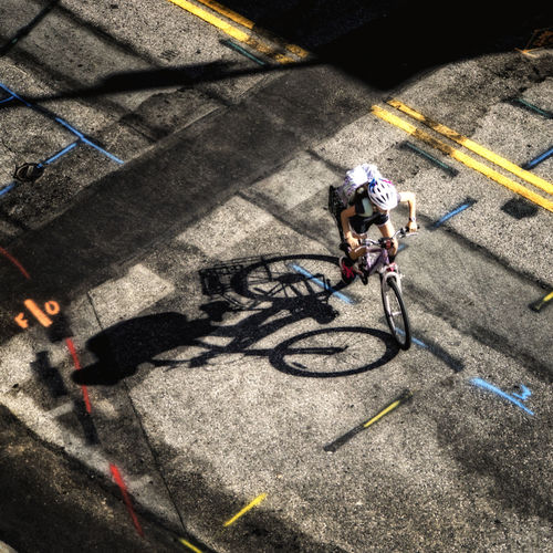 Riding to school Bycicle City Life High Angle View Mode Of Transport Ride Riding Road Marking School Ride Shadow Street Transportation