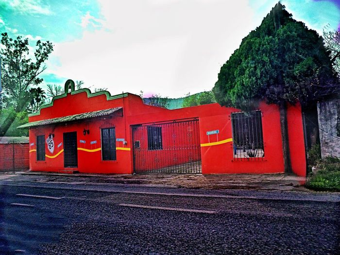 Whorehouse outside of Santiago, Mexico Whorehouse Brothel Red Prostitution Menstyle Sexygirl Mexico Mexican Whorehouse Red Tree Architecture Sky Building Exterior Built Structure Entry Archway Cobblestone Entrance Doorway Entryway Passage Closed Door Manhole  No Parking Sign