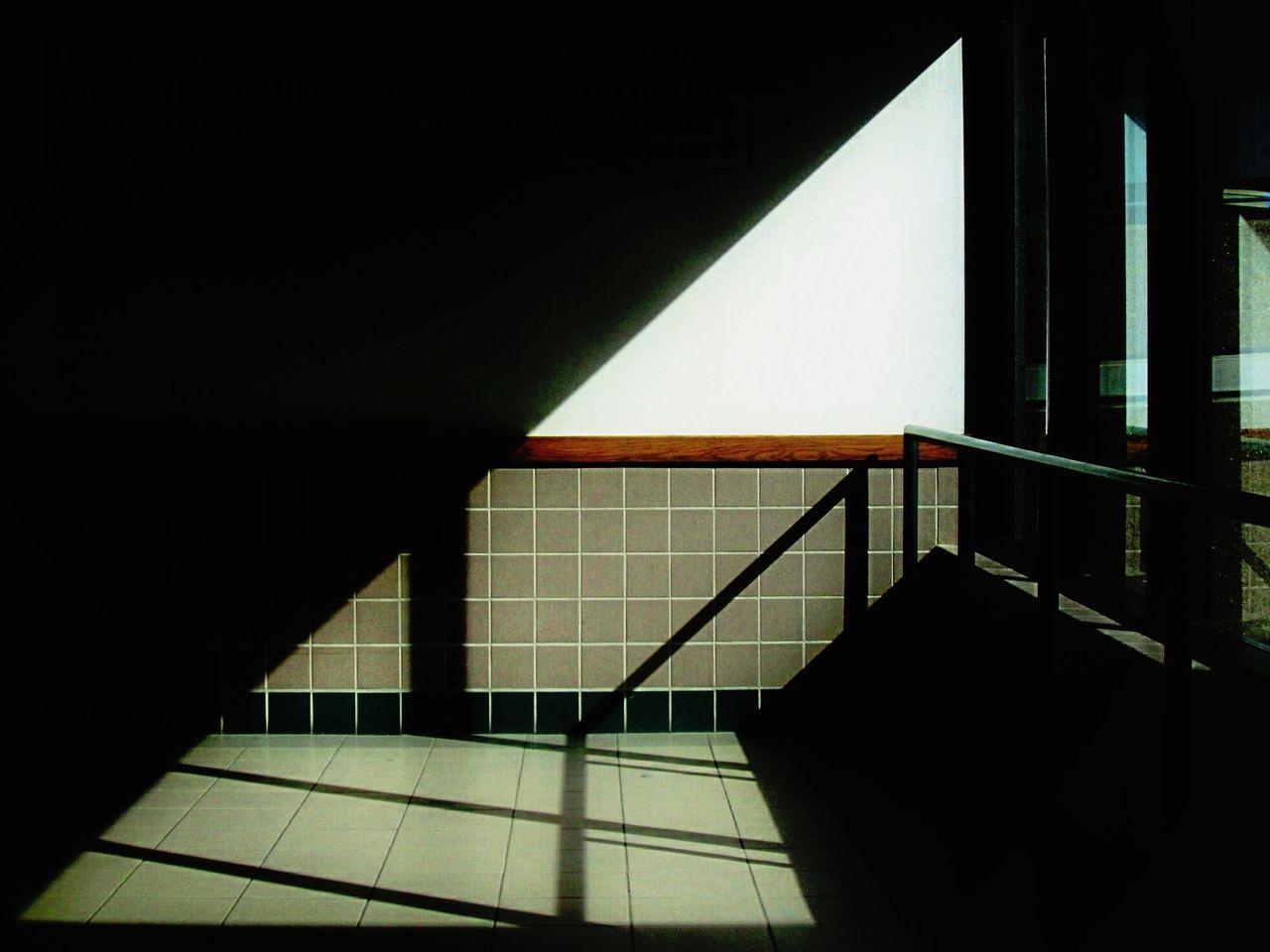 Shadow of railing in balcony