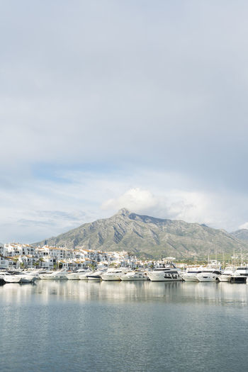 Puerto Banus SPAIN Mountain Clouds And Mountains Harbour Harbour View Water Sky Waterfront Architecture Scenics - Nature Cloud - Sky No People Built Structure Winter Nature Building Exterior Cold Temperature Beauty In Nature Day Mountain Range Transportation Sea Outdoors Boats