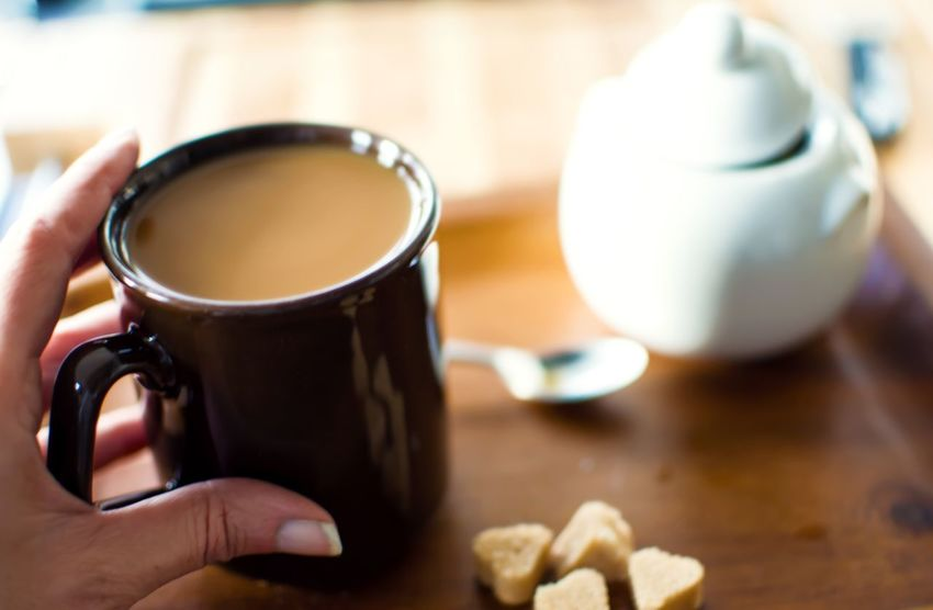 Woman holding cup of coffee with heart shaped sugar on wood table Personal Perspective Tranquility Comfort Cozy Woman Touch Coffee Break Drinking Coffee Coffee Mug Food And Drink Refreshment Drink Holding Cup One Person Mug Hand Human Body Part Human Hand Real People Hot Drink Indoors  Focus On Foreground Table Coffee Close-up Autumn Mood