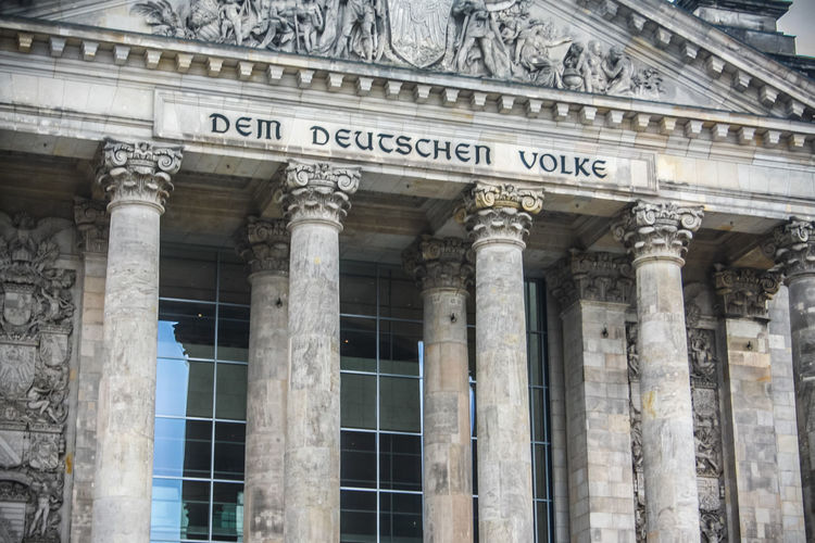 Architecture The Past History Government Building Exterior Architectural Column Text Built Structure No People Travel Destinations Façade Day City Low Angle View Finance Tourism Travel Craft Ancient Courthouse Ornate Reichstag Gouvermement Berlin