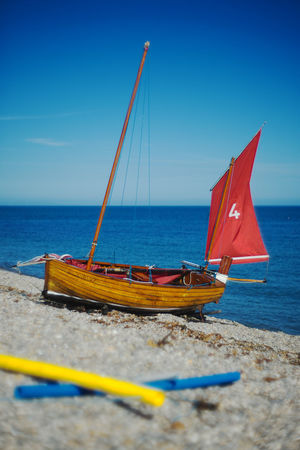 Holiday Travel Beach Beauty In Nature Blue Sky Boat Day England Moored Nature Nautical Vessel No People Outdoors Pebbles Sailboat Sea Sky Transportation Uk Vintage Water