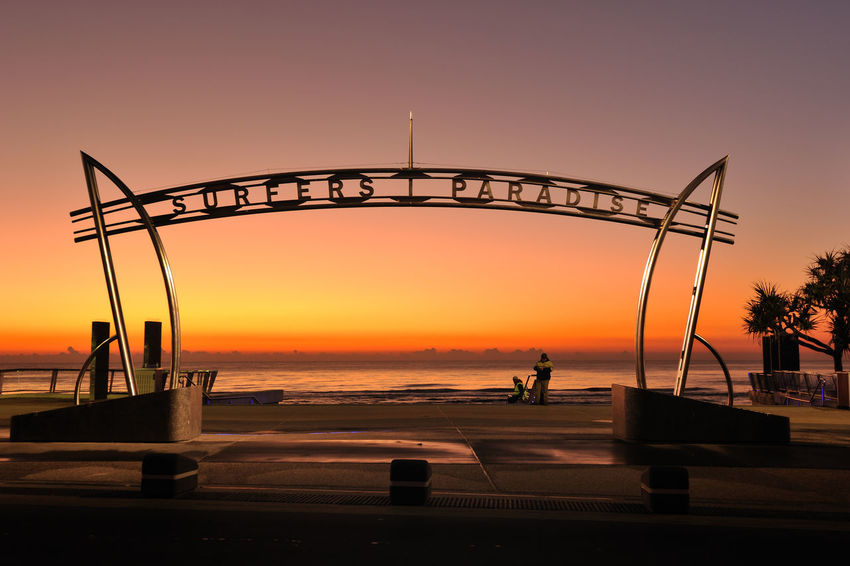 Sign Surfers Paradise Architecture Beach Beauty In Nature Horizon Over Water Nature Orange Color Outdoors Scenics Sea Silhouette Sky Sunset Water