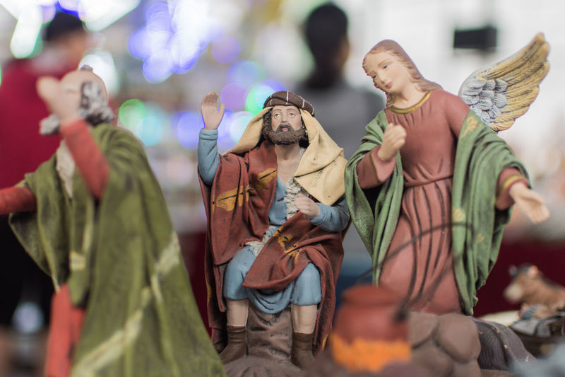 Close-up of jesus and angel figurines