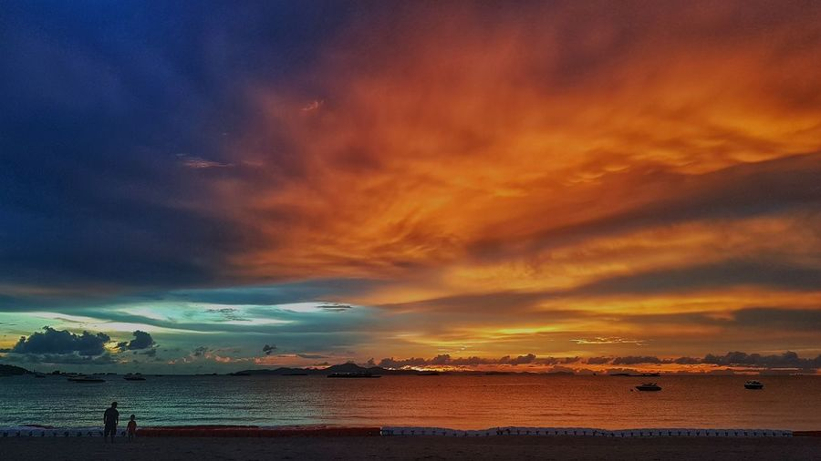 sunset and the beach Twilight Sunsets Water Sea Sunset Beach Wave Multi Colored Blue Sand Summer Red Romantic Sky Seascape Coast Moody Sky Calm Bay Of Water Atmospheric Mood