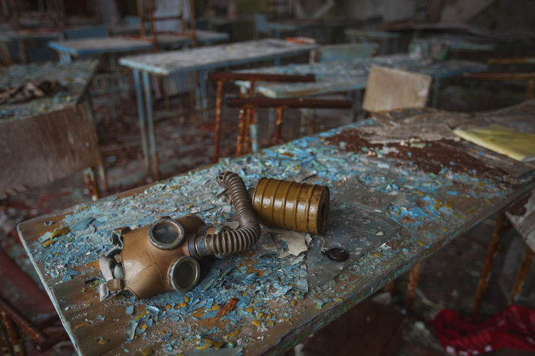 High angle view of gas mask on rusty table
