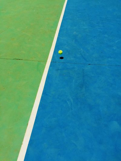 High angle view of yellow ball in swimming pool