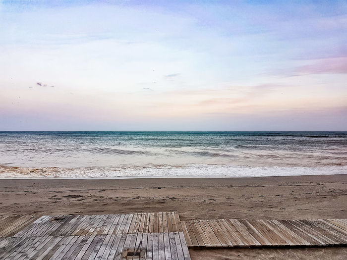 Winter beach Weather Season  Beachphotography Still Life Sand Beach Life Tranquility Mindfulness Calm Nature Pathway Sea And Sky Seascape Horizon Over Water Waves, Ocean, Nature Water Sea Beach Salt - Mineral Clear Sky Pastel Colored Sand Blue Sunset Calm Wave