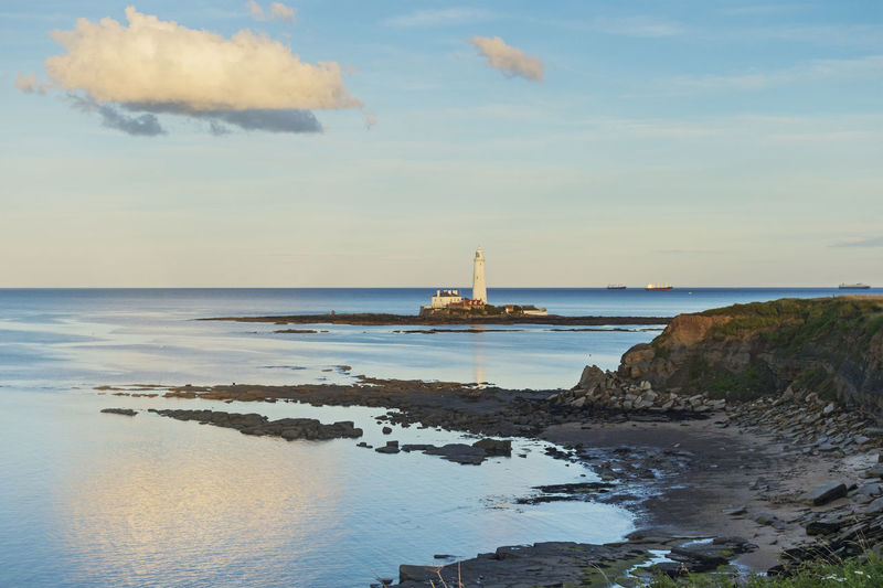 St Marys Island and lighthouse at dusk. Beach Building Exterior Cloud Cloud - Sky Coast Coastline Day Dusk Landscape No People North Sea Outdoors Reflection Rocks Sea Shipping  Sky St Marys Island St Marys Lighthouse Transportation Travel Destinations Uk Whitley Bay