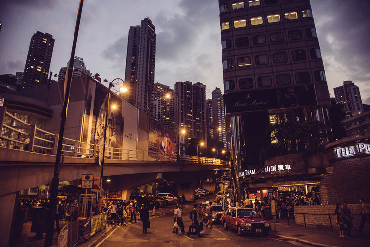 Hong Kong Streets Hong Kong Hong Kong City Architecture Building Building Exterior Built Structure Car City City Life Cityscape Cloud - Sky Dusk Illuminated Incidental People Light Mode Of Transportation Nature Night Office Building Exterior Outdoors Sky Skyscraper Street Street Light Streetphotography Transportation