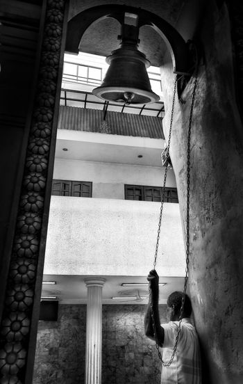 the holy bell Culture And Tradition Hindouism Hinduism Streetphotography Street Candid Photography Candid Peoplestreet Men Arch Built Structure Building Exterior