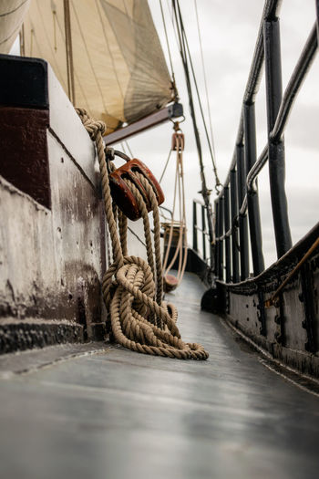 Low angle view of ropes hanging down the sail in a sailing ship