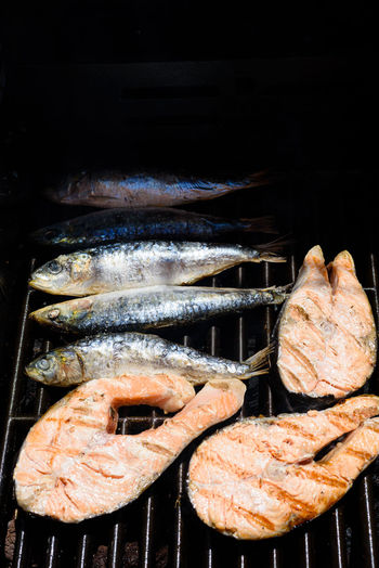 High angle view of fish on barbecue grill