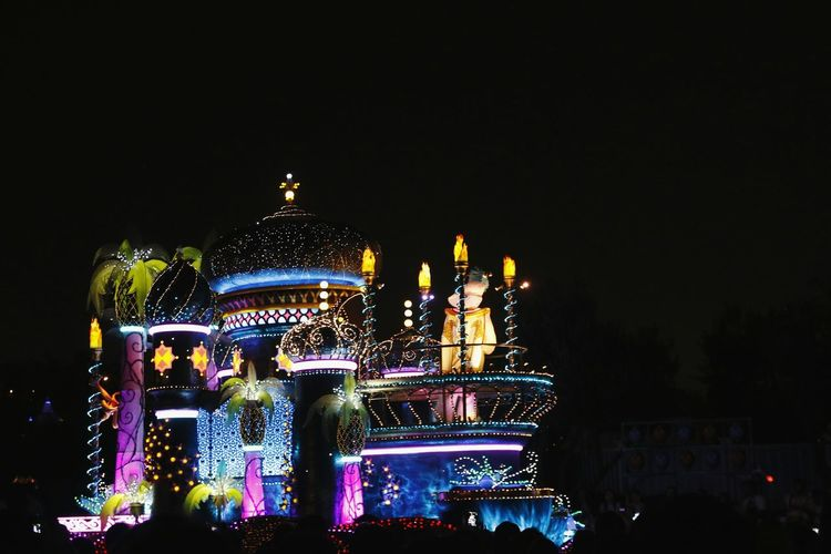 Illuminated temple against clear sky at night
