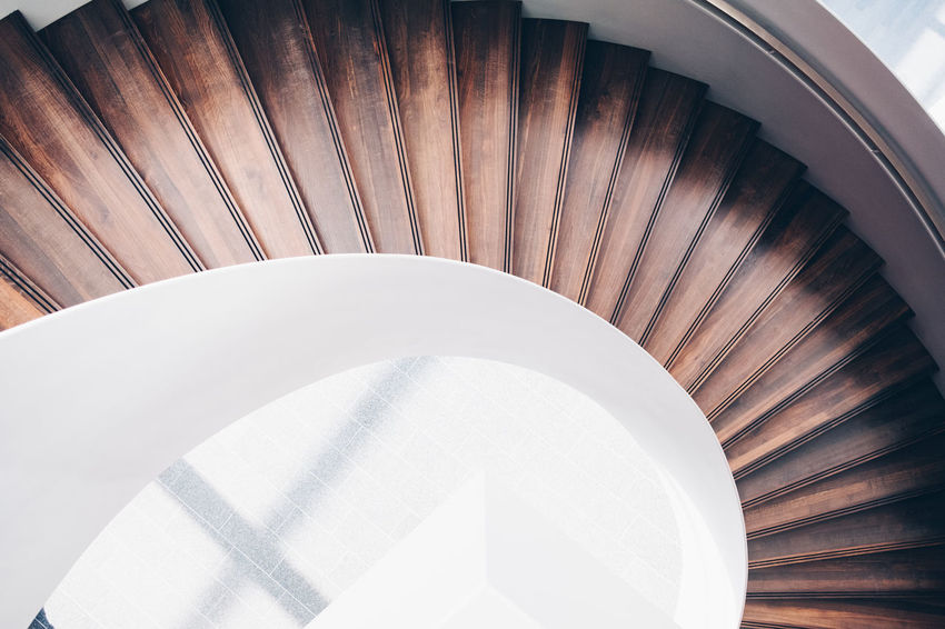 Staircase Spiral Staircase Steps And Staircases Spiral Indoors  Built Structure High Angle View Architecture Railing No People Pattern Directly Above Design White Color Wood - Material Curve Absence Modern Still Life Empty