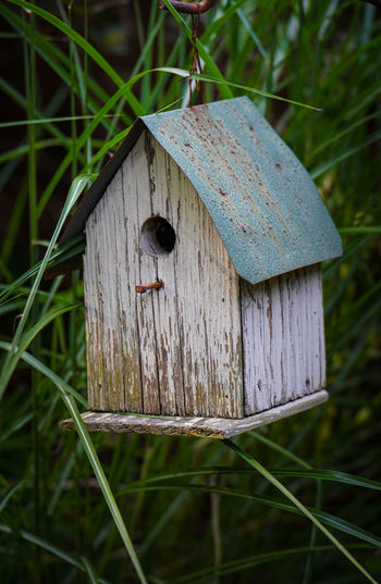 Close-up of birdhouse on field
