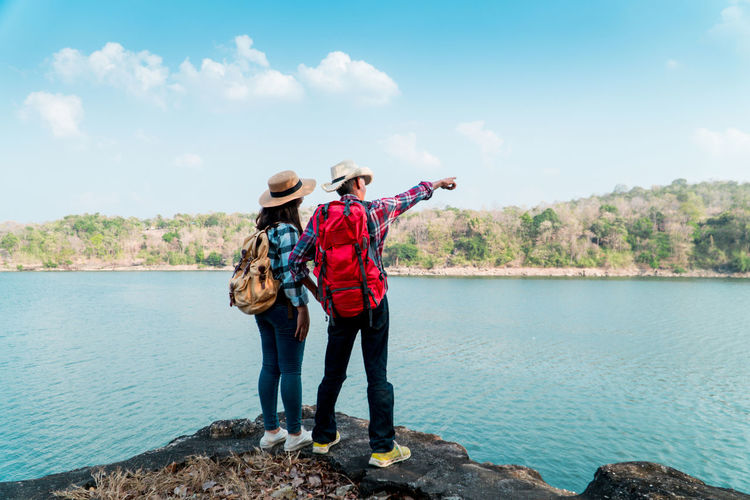Travel Vacation Holiday Relaxing Rest Destination Nature Backpack Bag Journey Tourism Water Sky Lifestyles Standing Lake Two People Women People Adult Outdoors Togetherness Day Man