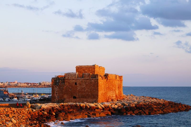 Cyprus Paphos Cyprus Paphos Port Nautical Vessel Sea And Sky Blue Sea Clouds And Sky Cloud - Sky Rock Structure Castle View  Castles Castle Sky Architecture Cloud - Sky Built Structure Sea Building Exterior Water Day Outdoors Nature Horizon Over Water History Beauty In Nature Scenics