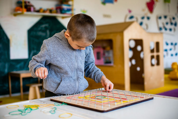 Boy playing on table at home