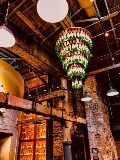 Jameson's - Bow Street Distillery - you'll be hanging from the chandelier Interior Mobilephotography ShotOnIphone IPhoneography Ireland Dublin Travel Photography Tourist Tourism Travel Drink Bar Pub Warmth Warm Chandelier Jamesonwhiskey Whiskey Jameson Architecture Lighting Equipment Built Structure Low Angle View Lantern Illuminated Travel Destinations Indoors  Architectural Column Day City