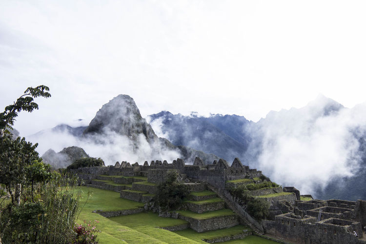 Machu Picchu with deep hanging clouds Machu Picchu Ancient Ancient Civilization Archaeology Architecture Beauty In Nature Clouds Day Environment Famous Place Fog History Inca Ruins Landscape Mountain Nature No People Outdoors Plant Scenics - Nature Sky The Past Tourism Travel Travel Destinations