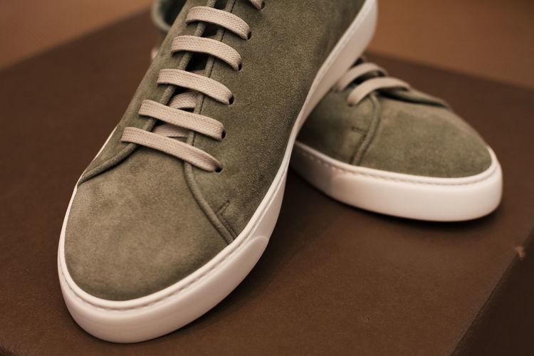 Close-up of canvas shoes on table