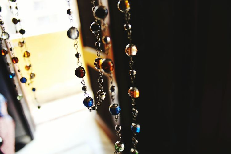 Close-up of necklaces hanging at home