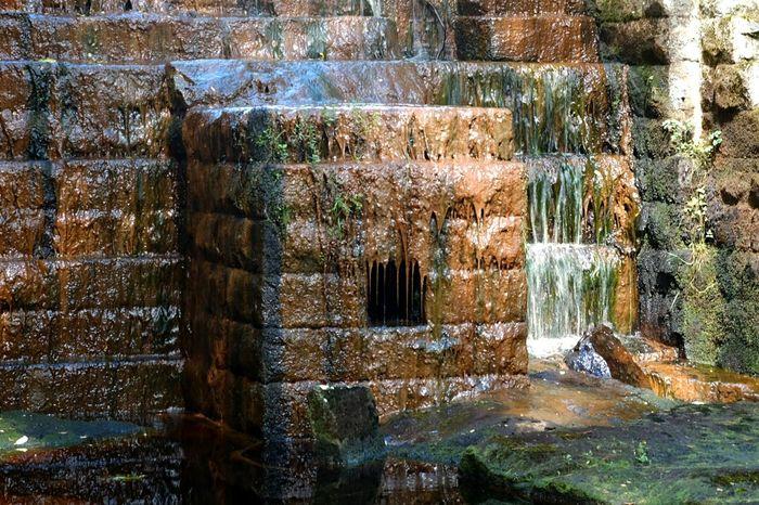 Blackburn lake sluice gate Cragside X-M1 National Trust Northumberland Bricks Water
