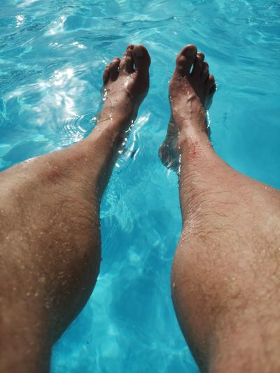 Low section of man in swimming pool