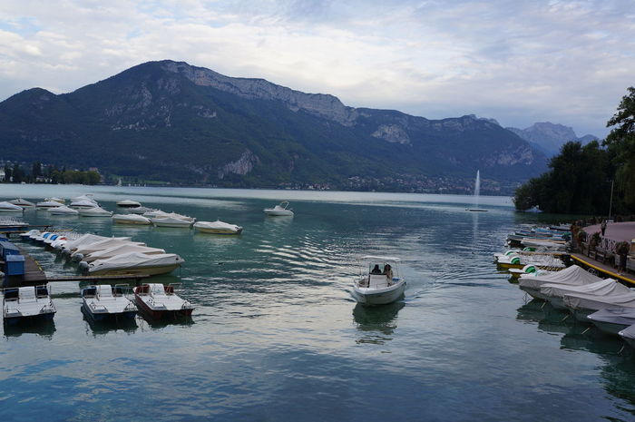 Annecy lake Annecy Lake Annecy Le Vieux Beauty In Nature Boat Built Structure Cloud Cloud - Sky Lake Mode Of Transport Moored Mountain Mountain Range Nature Nautical Vessel Nobody Reflection Scenics Sky Tourism Tranquil Scene Tranquility Transportation Traveling Water Waterfront