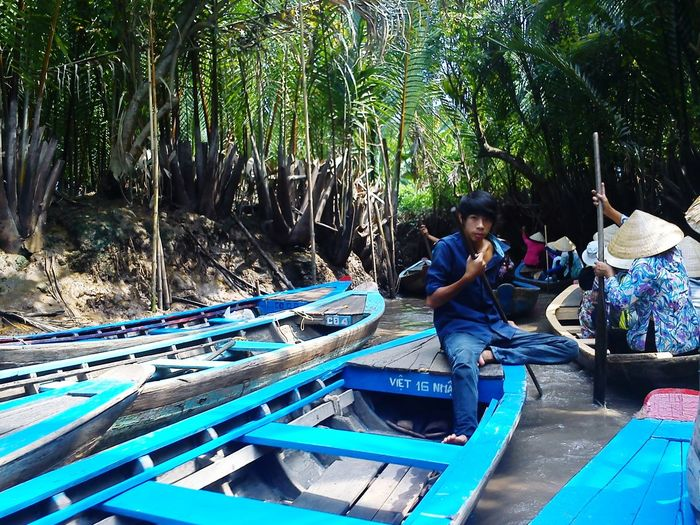 EyeEmNewHere Sitting Real People Two People Day Tree Outdoors People Nautical Vessel Full Length Men Women Adult Nature Adults Only Only Women Young Adult Vietnamese River Road EyeEm Selects Investing In Quality Of Life Done That.