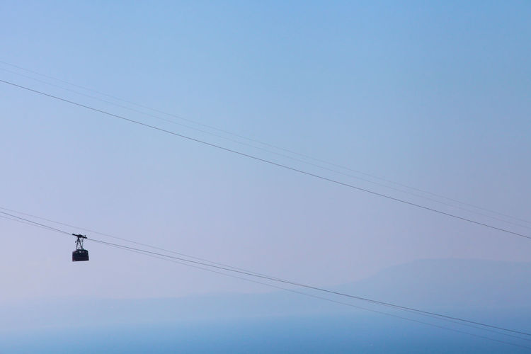 Sky And Clouds Travel Beauty In Nature Blue Blue Sky Bluesky Cable Clear Sky Connection Day Electricity  Hanging Landscape Low Angle View Nature No People Outdoors Overhead Cable Car Photo Photography Photooftheday Power Line  Power Supply Sky Technology EyeEmNewHere Stories From The City