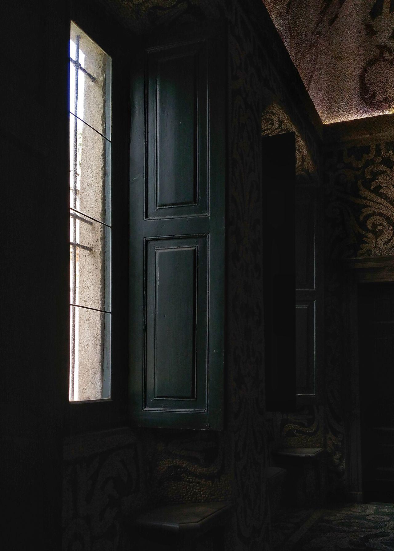 Open window of abandoned villa