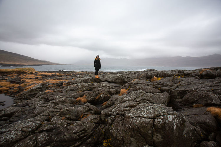 Rock Moody Sky Landscape_Collection Landscape Nature Iceland Memories Iceland_collection Iceland Rock - Object One Person Standing Real People Beauty In Nature Tranquil Scene Rock Formation Outdoors Leisure Activity Water