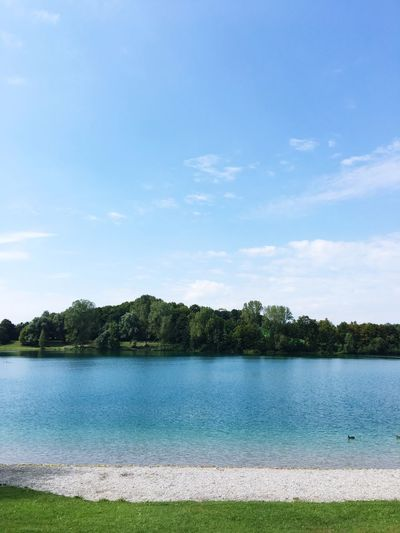 Water Tranquil Scene Tranquility Sky Blue Tree Scenics Lake Nature Day Calm Countryside Solitude Outdoors Growth Remote Green Color Cloud - Sky Shore