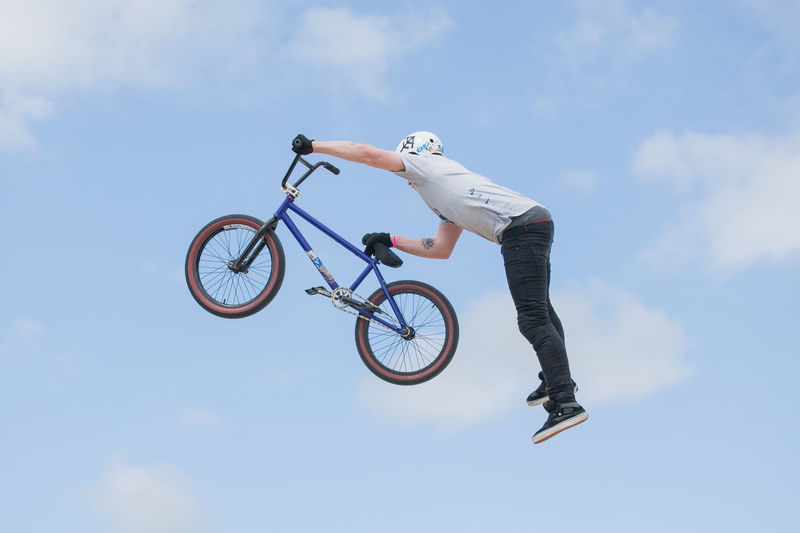 Low angle view of man riding bicycle